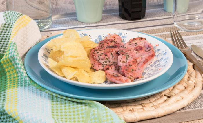 Chuleta de pavo ajillo cocinado