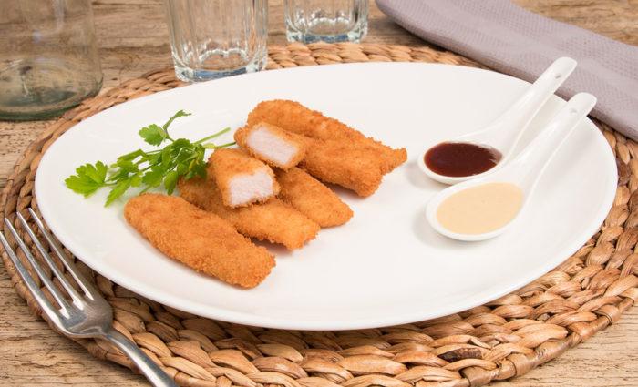 Fingers de pechuga de pollo empanados cocinados